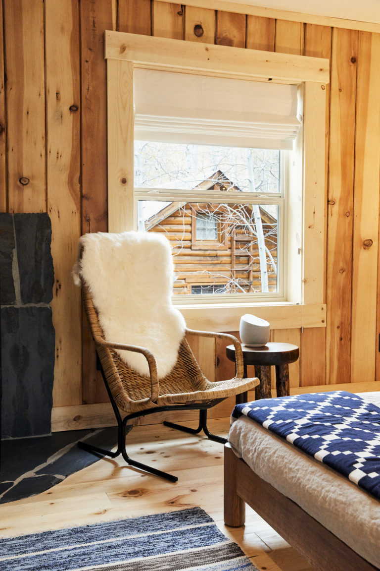 Chair with fur throw by cabin window