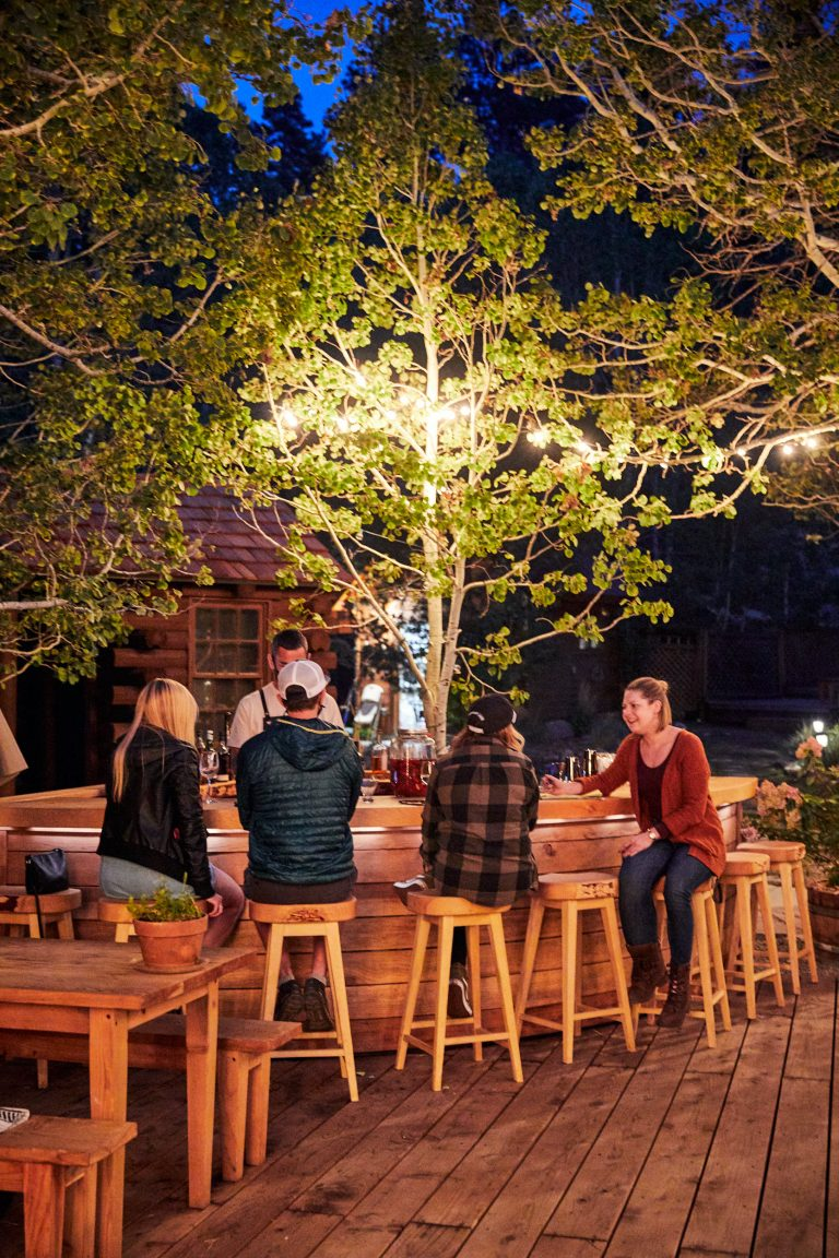 group of people sitting at outdoor bar