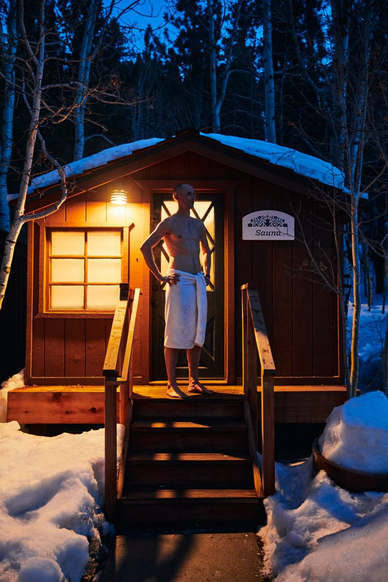 Person standing outside of sauna