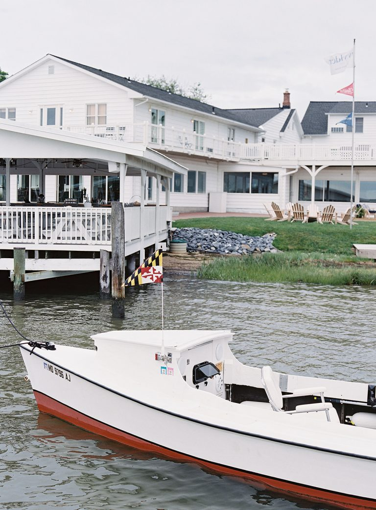 boat with hotel in background