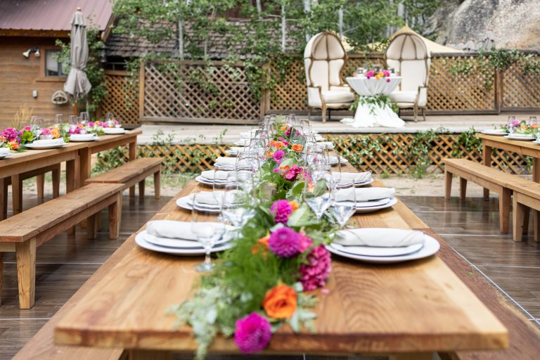 table for lots of guests and flowers